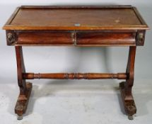 A late Victorian mahogany two drawer writing table with dual ended supports united by turned