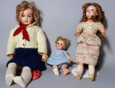 A Simon & Halbig bisque head doll and two further early 20th century bisque head dolls, (3).