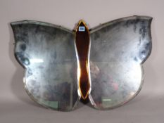 A mid-20th century Art Deco wall mirror with bevelled glass formed as a butterfly,