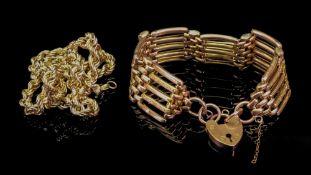 An early 20th century gatelink bracelet, the heart shape padlock clasp detailed 9ct,