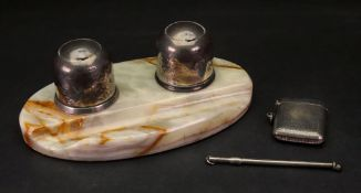A pair of silver inkwells, Birmingham 1919, with sliding covers, on oval onyx marble base,