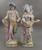 A large pair of Paris porcelain figures of a male artist and female musician, late 19th century,