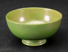 A small Moorcroft green lustre bowl, early 20th century, impressed Moorcroft, Liberty paper label,