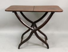 An early Victorian mahogany coaching table, with divided hinged rectangular top,