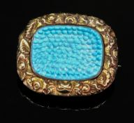 An early Victorian panel brooch, with foliate engraved border,