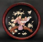 A Japanese ivory, wood and mother of pearl inlaid circular lacquer panel, Meiji period,