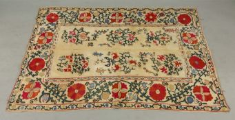 An early 20th century Susani, the central field worked in coloured threads with floral motifs,