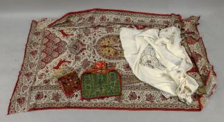 An Indian embroidered linen cloth, embroidered with a circular motif and edging, 120 x 115cm,