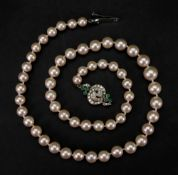 A single row cultured pearl necklace, of graduated design, the cultured pearls measuring from 10.
