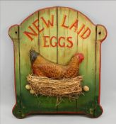 A handpainted reproduction advertising board for New Laid Eggs, Rhode Island Red,