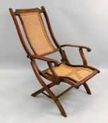 A fluted walnut frame folding campaign armchair, late 19th century, with cane panel back and seat,