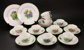 A Copenhagen tea service, 20th century, individually painted with flowers, eleven cups,