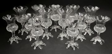 A set of seven glass thistle shape posy vases, late 19th/early 20th century,
