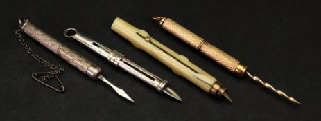 A 9ct gold propelling toothpick, Birmingham 1991, in cylindrical engine turned case,