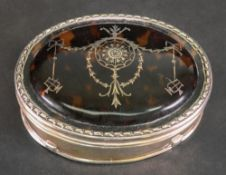 An oval silver mounted tortoiseshell dressing table box, William Comyns, London 1912,