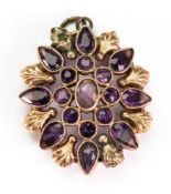 A Victorian amethyst-set pendant, with seventeen amethysts in a floral design, 4.8g gross.