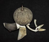 A Napoleon III silver 5 Francs 1868, now adapted and containing a pair of folding steel scissors,