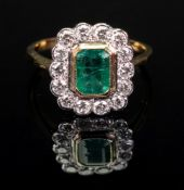An 18ct gold, emerald and diamond-set ring of cluster design,