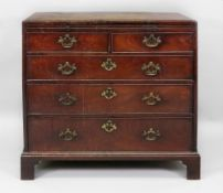 A George III mahogany chest, the moulded rectangular caddy top above a brushing slide,