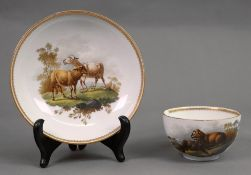 A Meissen teacup and saucer, circa 1760-70, each painted with two sheep in a landscape,