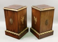 A pair of reproduction George III style mahogany giltwood and gesso square pedestals,
