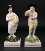 A pair of English pearlware figures, representing Summer and Autumn, circa 1800,