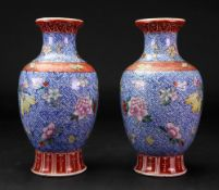 A pair of Chinese famille rose baluster vases, Qianlong seal mark, but later,