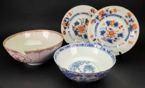 A Chinese blue and white bowl, circa 1900, painted with two dragons amongst flowers,