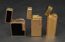 Cartier; a gilt metal lighter of rounded rectangular design with ribbed detailing, number C85847,