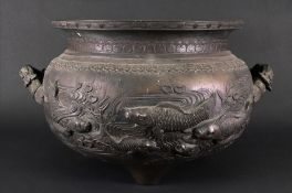 A large Chinese two-handled bronze jardiniere, decorated with fish in a pond,