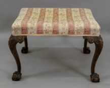 A Chippendale style mahogany dressing stool, circa 1900,
