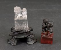 A small Chinese rock crystal carving of a Buddhist lion, standing on a rectangular plinth, 4.