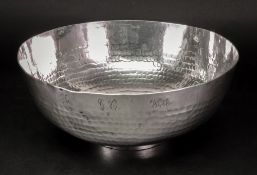 A Zanzibar spot hammered circular bowl, 23cm diameter, 28.8ozs, inscribed around the side 'To G.C.