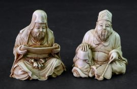 Two Japanese ivory figures of scholars, Meiji period, each carved seated, one holding a scroll,