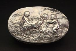 A late 19th century oval silver dressing table box, English Import marks for London 1892,