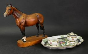 A Beswick figure of a Thoroughbred stallion, standing on an oval wooden plinth base, 22.