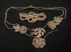A twisted five-strand rope of seed pearls, to a barrel shape clasp,
