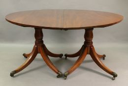 A Regency style mahogany 'D' end dining table, 19th century, with extra leaf,