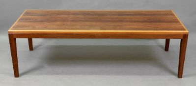 A contemporary rosewood and banded low centre table, the rectangular top on square tapered legs,