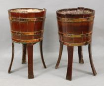 A pair of George III style brass bound coopered teak jardinieres, 19th century, on splayed legs,