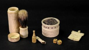A turned, carved and pierced cylindrical ivory pin cushion, 19th century, with slightly flared rim,