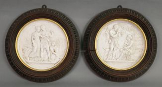 A pair of continental biscuit porcelain circular plaques, probably Copenhagen, 19th century,
