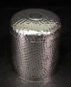 A spot hammered cylindrical silver box, Robert Rowlands, Birmingham 1912, with pull-off cover,