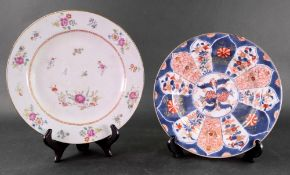 A Chinese Export famille rose plate, Qianlong, painted with scattered flowers, an insect and bird,