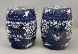 A pair of Chinese blue ground barrel shaped garden seats, circa 1900,