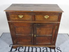 A 19th century and later oak dresser base with two drawers over cupboard base,