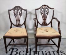 A set of six George III style mahogany shield back dining chairs, to include two carvers,