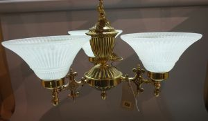 A pair of Victorian single brass three branch chandeliers, with frosted glass shades,