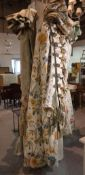 Curtains; a pair of white ground lined and interlined curtains with all over floral design,