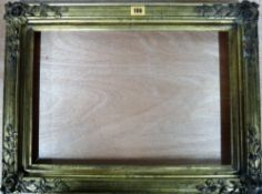 An early 20th century gilt plaster frame, a folio containing four modern prints,